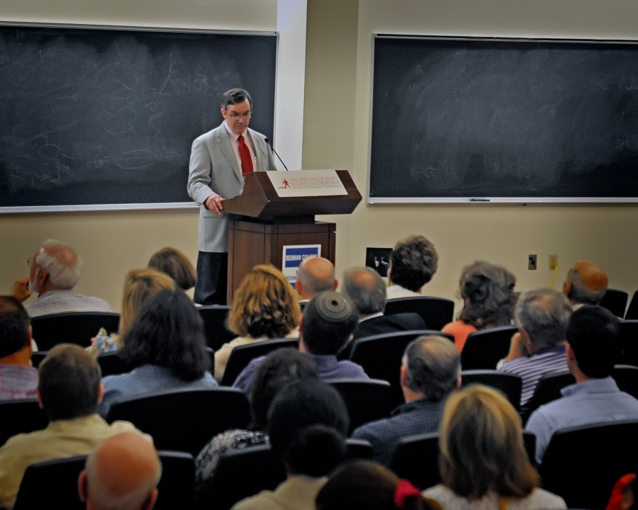 Dr. Geoffrey Megargee speaks to a large crowd at SMU's Dallas Hall